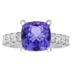 White Gold and Princess Cut Diamonds Ring with Cushion Cut Tanzanite Center