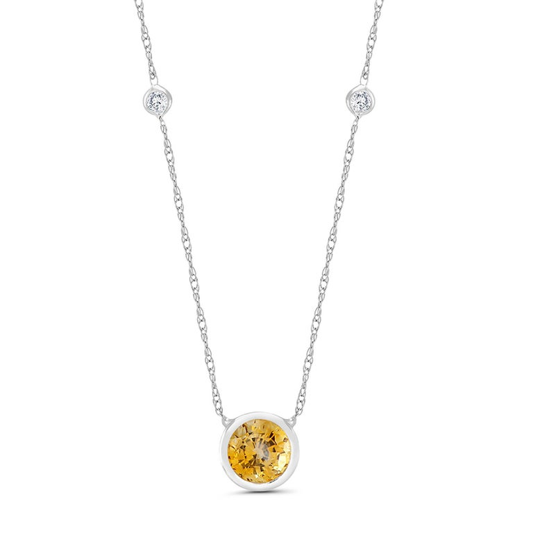 14 karat white gold necklace pendant with one yellow sapphire and two round diamond  Measuring 16 inch long Diamond total weight 0.10 carat Yellow Sapphire weight 0.70 carat Bezel of Yellow sapphire measuring 0.28