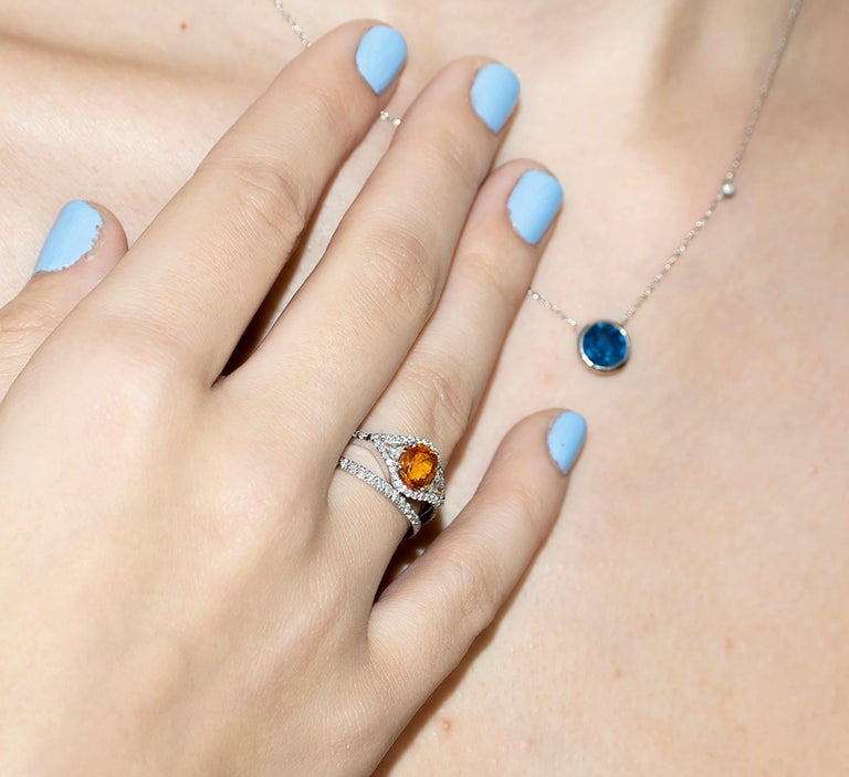14 karat white gold necklace pendant  Measuring 16 inch long Sapphire weight 1.25 carat Sapphire measures 7 millimeter Outside bezel measures 0.30