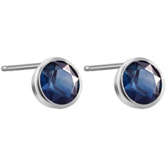 White Gold Bezel Set Stud Earrings with Pair Sapphire Weighing 1.60 Carat