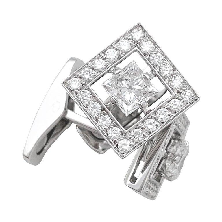 An 18 Kt white gold pair of Boucheron cufflinks,