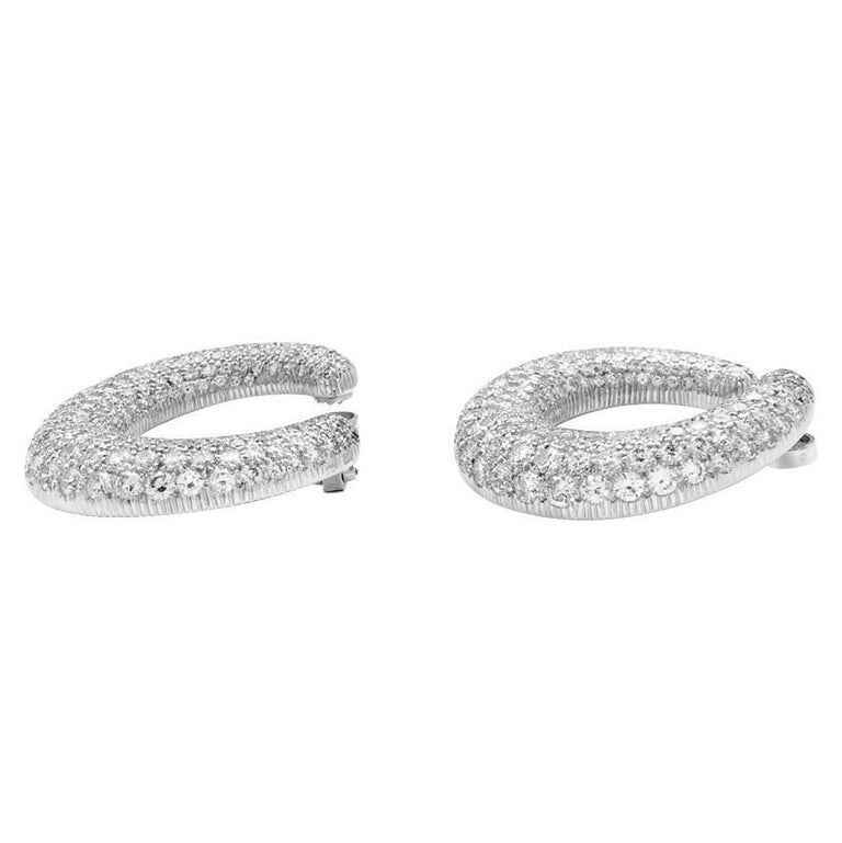 A 750/000 white gold, Cartier hoop earrings, entirely paved with brilliant cut diamonds for a total weight of about 13 carats. Clip system. Circa 1990
