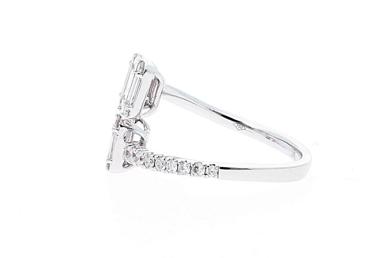 White Gold Contrarie Ring with Baguette Cut Diamonds  Cut Diamonds: baguette and round Total weight: Carat 0.82 Gold weight: 3.2  Size IT 12, USA 6, FR 52 Resizable If needed this would come complimentary with your purchase