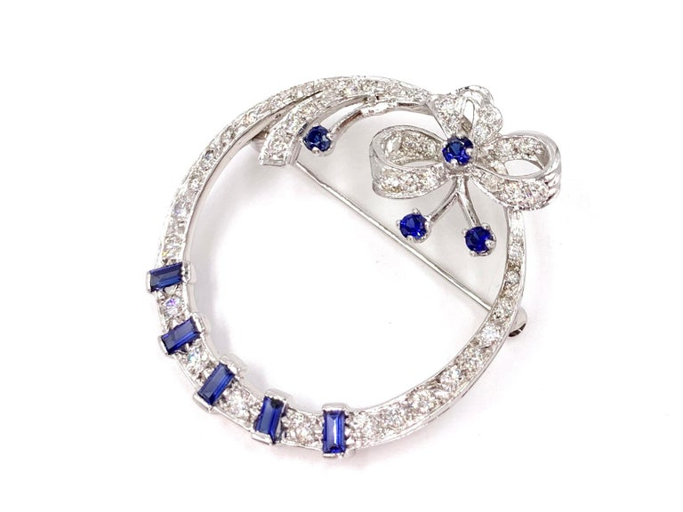 Edwardian White Gold Diamond and Sapphire Circle Bow Brooch For Sale