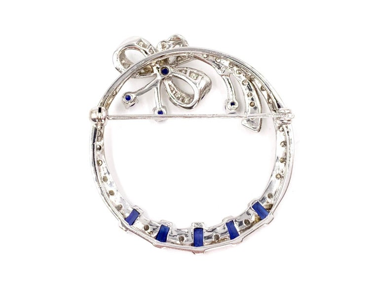 White Gold Diamond and Sapphire Circle Bow Brooch In Good Condition For Sale In Pikesville, MD