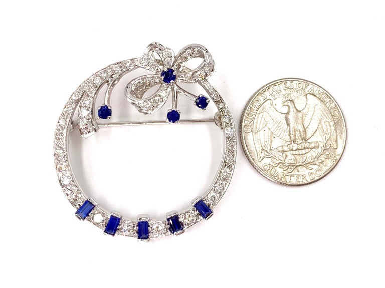 Women's or Men's White Gold Diamond and Sapphire Circle Bow Brooch For Sale