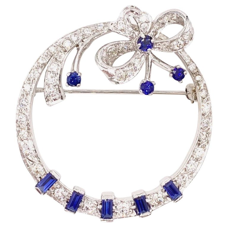 White Gold Diamond and Sapphire Circle Bow Brooch For Sale