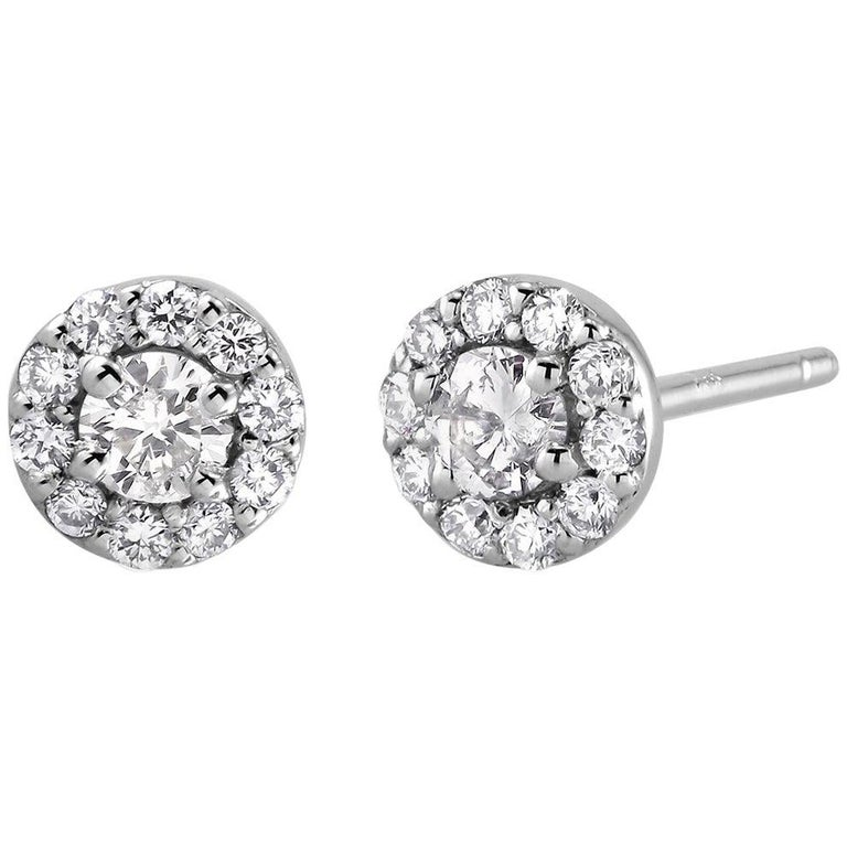 White Gold Diamond Center and Pave Diamonds Halo Style Stud Earrings For Sale