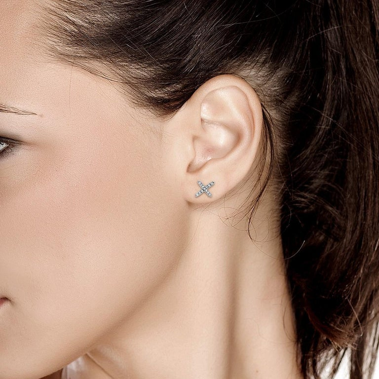 Contemporary White Gold Diamond Cross Stud Earrings For Sale