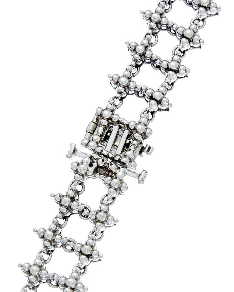 White Gold Diamond Necklace with the drop   14K white gold necklace with 8.80 carats of  round shaped diamonds in a prong setting  Length: 16