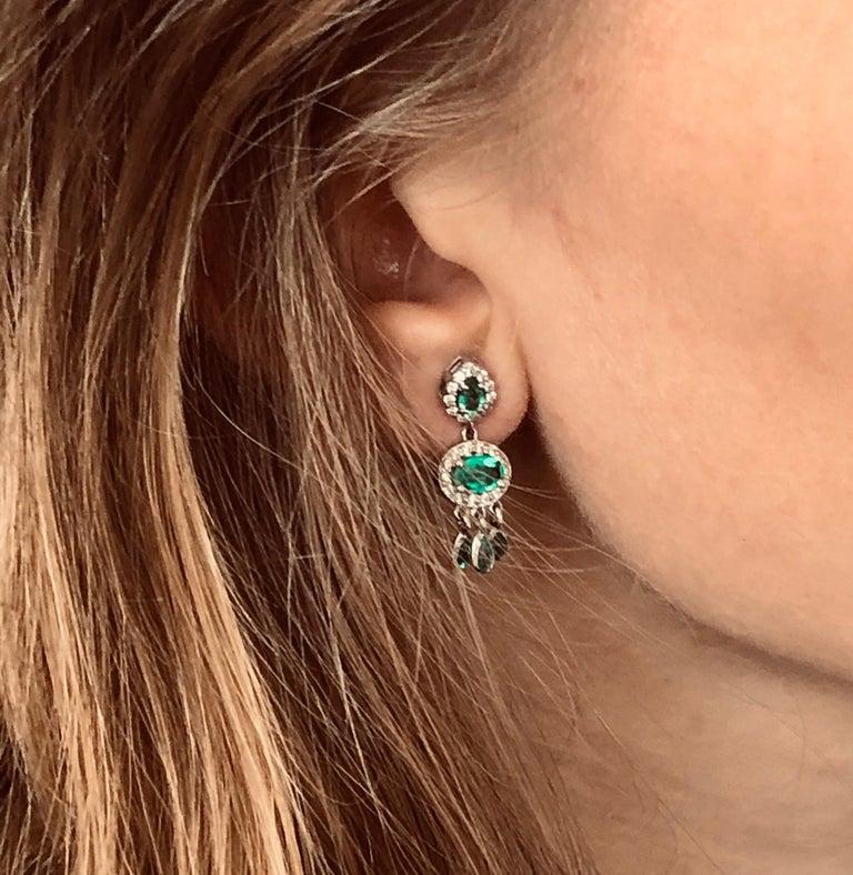 Oval Cut Diamond and Emerald Drop Dangle Eighteen Karat White Gold Earrings  For Sale