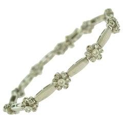 White Gold Diamond Flower Tennis Bracelet