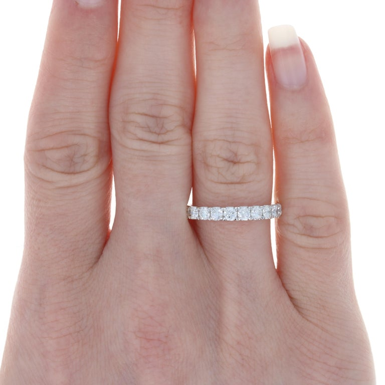 Size: 6 Sizing Fee: Up 1 size for $40  Metal Content: 18k White Gold  Stone Information:  Natural Diamonds Total Carats: .94ctw Cut: Round Brilliant Color: F - G Clarity: SI1 - SI2  Style: Wedding Band with Diamonds  Face Height (north to south):
