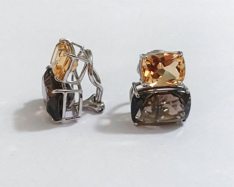 Elegant 18kt White Gold Double Cushion Earrings with Faceted Citrine and Smokey Topaz.  This is a classic day to evening earring that can be made clip or pierced. The meaning measures 3/4' tall and 1/2