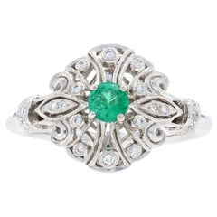 White Gold Emerald and Diamond Ring, 14 Karat Round Cut .22 Carat Milgrain