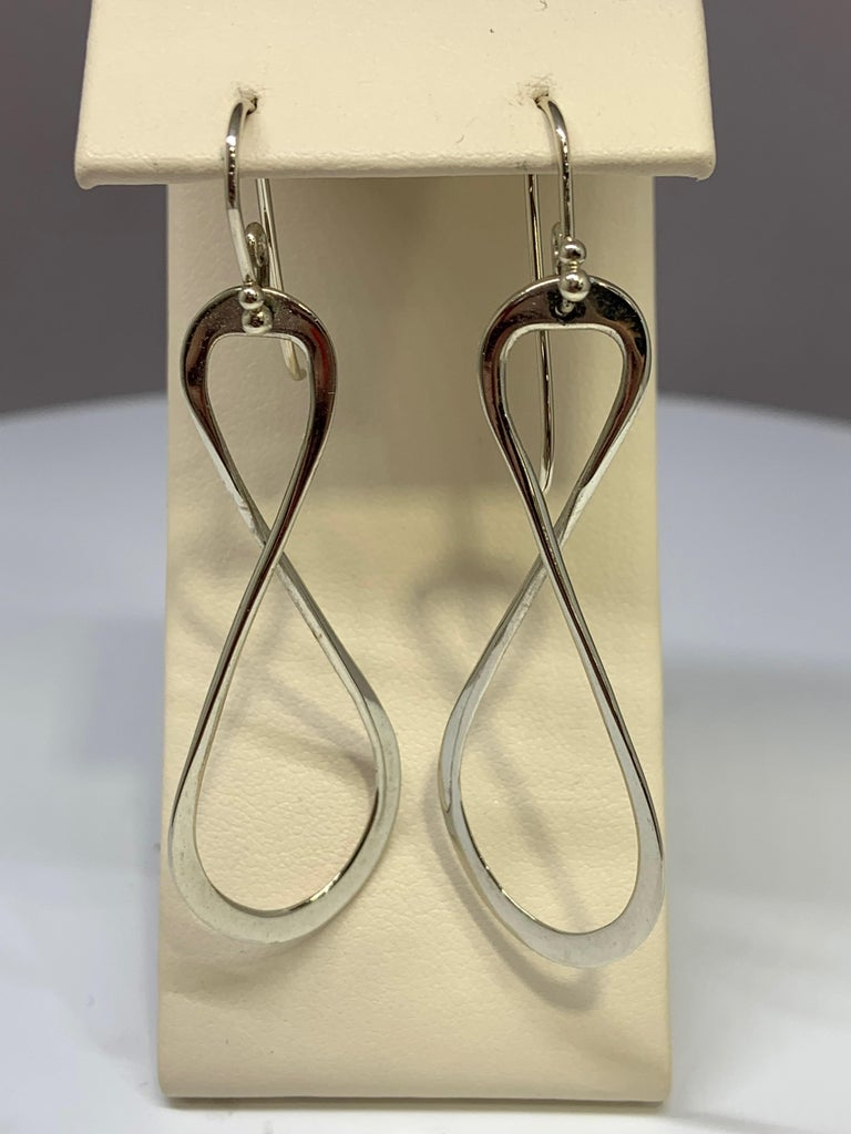 These figure 8 drop earrings are made of 14k white gold and have a high polished finish. These earrings are perfect for both casual and dressy occasions!