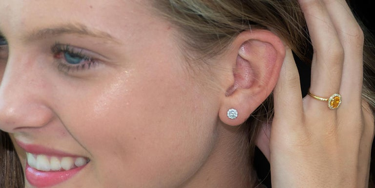 14 karat white gold halo diamond earrings  Diamond weighing 0.50 carat New Earrings Width 0.25