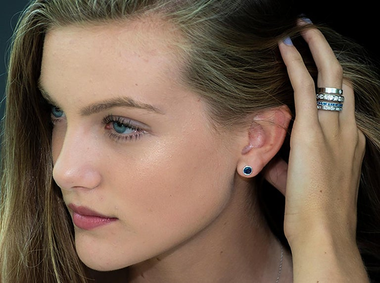 Contemporary White Gold Halo Diamond Earrings Weighing 0.50 Carat For Sale