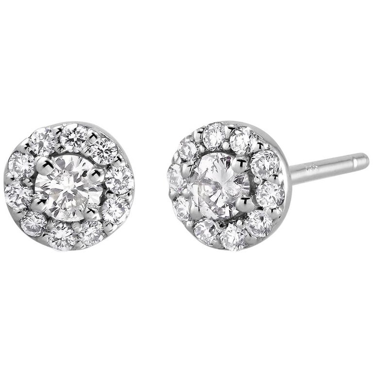 White Gold Halo Diamond Earrings Weighing 0.50 Carat For Sale