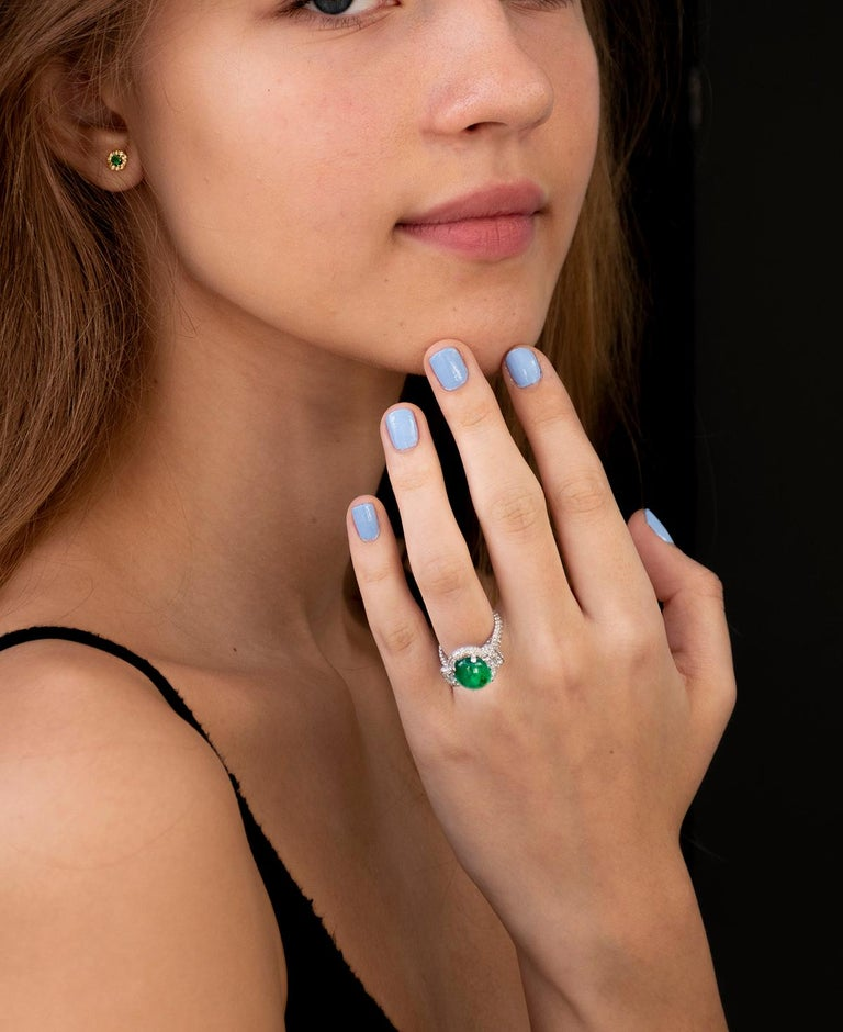 14 karat white gold halo emerald and diamond earrings  Emerald weight 0.20  Diamond weighing 0.27 carat New Earrings Width 0.25 inch The halo setting is a setting that encircles any shaped gemstone with tiny round cut diamonds  Our design team