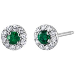 White Gold Halo Emerald Diamond Earrings Weighing 0.47 Carat