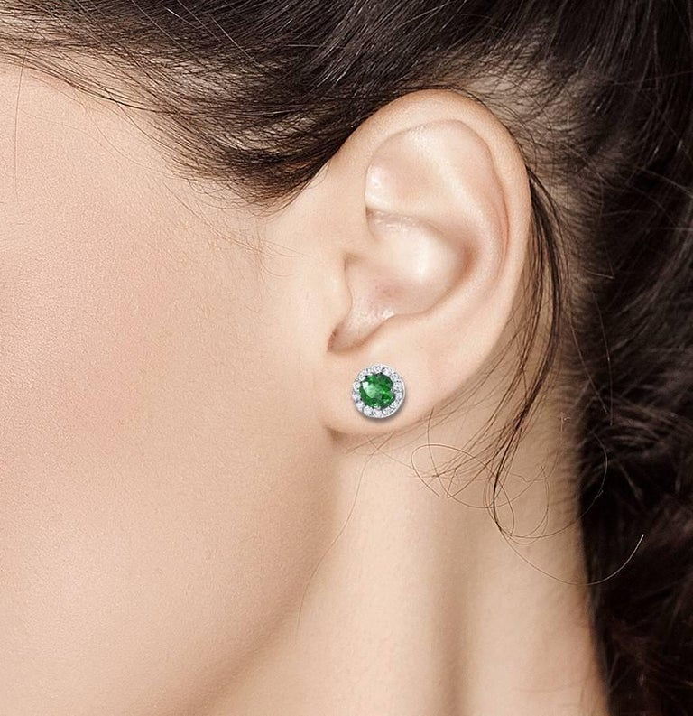 Contemporary White Gold Halo Emerald Diamond Earrings Weighing 1.25 Carat For Sale