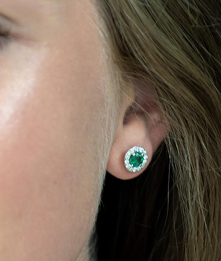Round Cut White Gold Halo Emerald Diamond Earrings Weighing 1.25 Carat For Sale