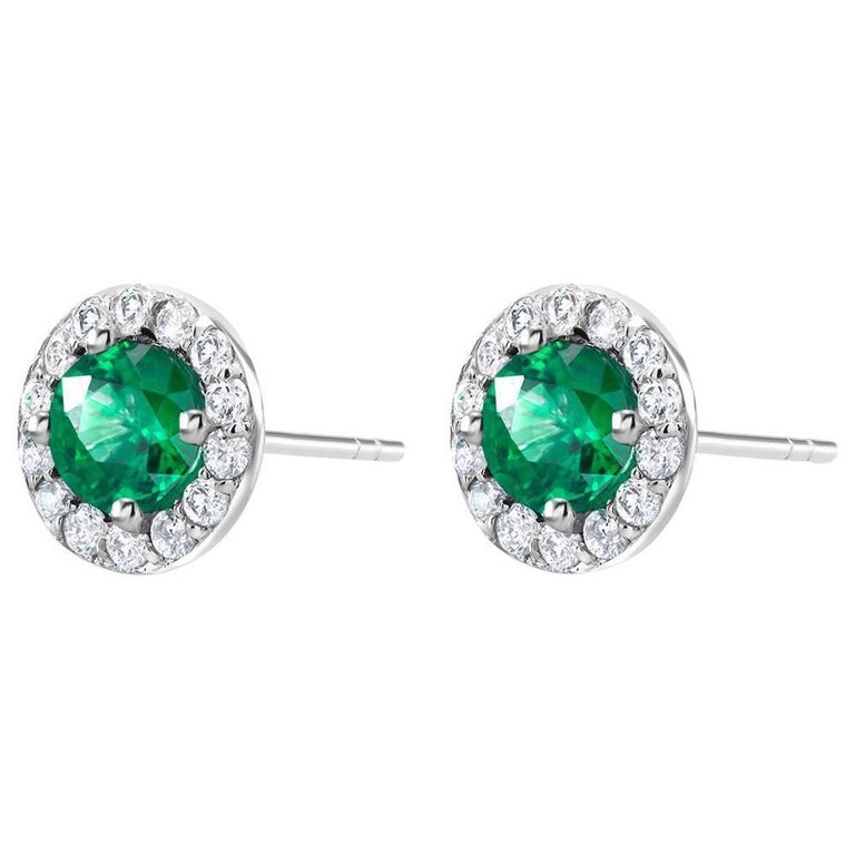 White Gold Halo Emerald Diamond Earrings Weighing 1.25 Carat For Sale
