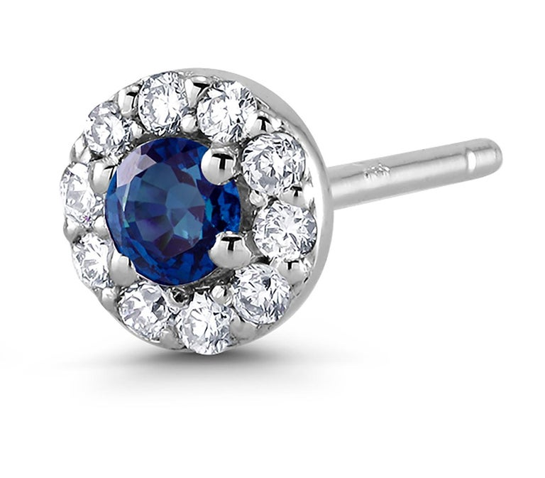 Contemporary White Gold Halo Sapphire Diamond Earrings Weighing 0.60 Carat For Sale