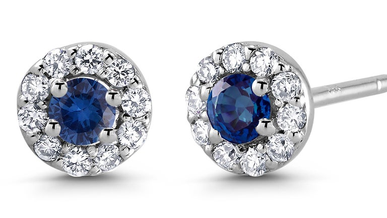 Round Cut White Gold Halo Sapphire Diamond Earrings Weighing 0.60 Carat For Sale