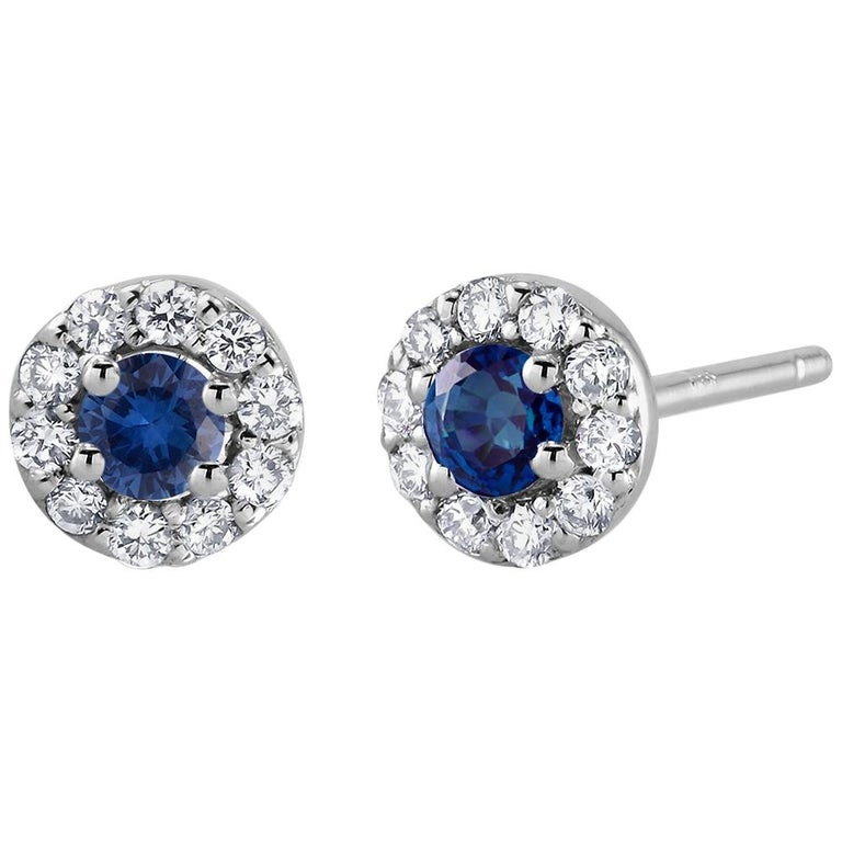 White Gold Halo Sapphire Diamond Earrings Weighing 0.60 Carat For Sale