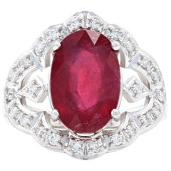 White Gold Lead Glass Filled Ruby and Diamond Ring, 14k Oval Brilliant .24 Carat