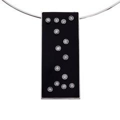 White Gold, Onyx and Diamond Pendant