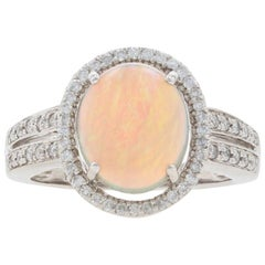 White Gold Opal and Diamond Halo Ring, 14 Karat Oval Cabochon Cut 2.37 Carat