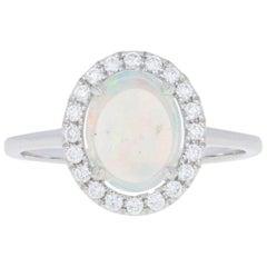 White Gold Opal and Diamond Ring, 14 Karat Oval Cabochon Cut .53 Carat Halo
