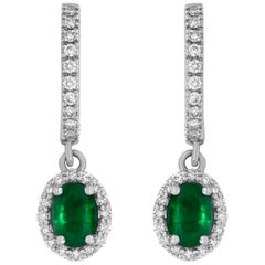 White Gold Oval Shaped Emerald and White Diamond Halo Drop Earring