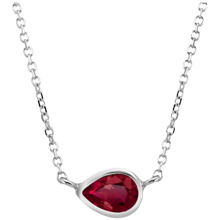 White Gold Pear Shape Ruby Bezel Set Pendant Necklace Weighing 0.95 Carat For Sale