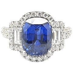 White Gold Ring with a 5.50 Carat Pillow Shaped Faceted Sapphire and Diamonds