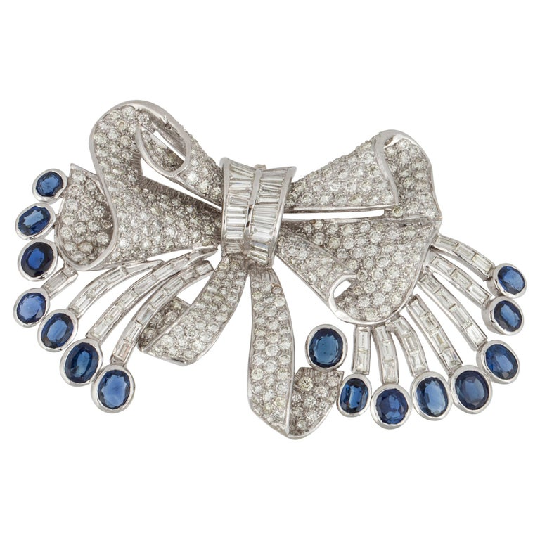 White Gold Sapphire Diamond Bow Pin For Sale