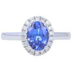 White Gold Tanzanite and Diamond Ring, 18 Karat Oval Cut 1.43 Carat Halo