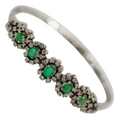White Gold Tennis Bracelet with Emeralds and Diamonds
