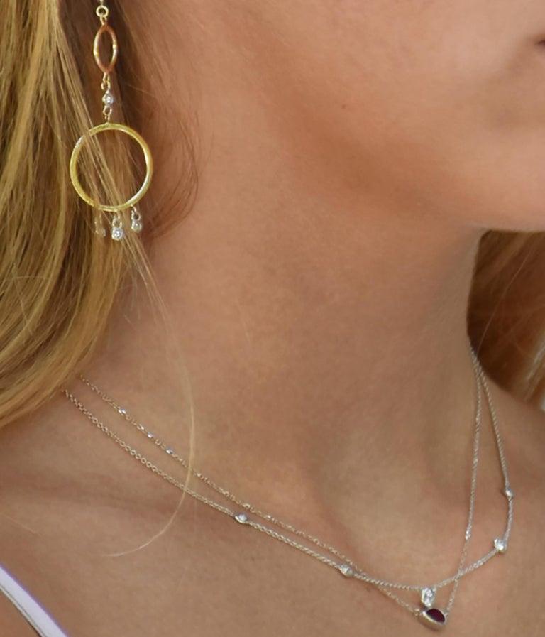 Modernist White Gold Three Graduating Diamond Bezel-Set Pendant Weighing 0.45 Carat For Sale