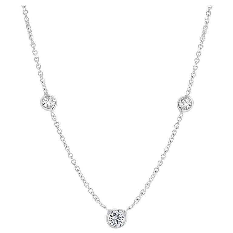 White Gold Three Graduating Diamond Bezel-Set Pendant Weighing 0.45 Carat For Sale