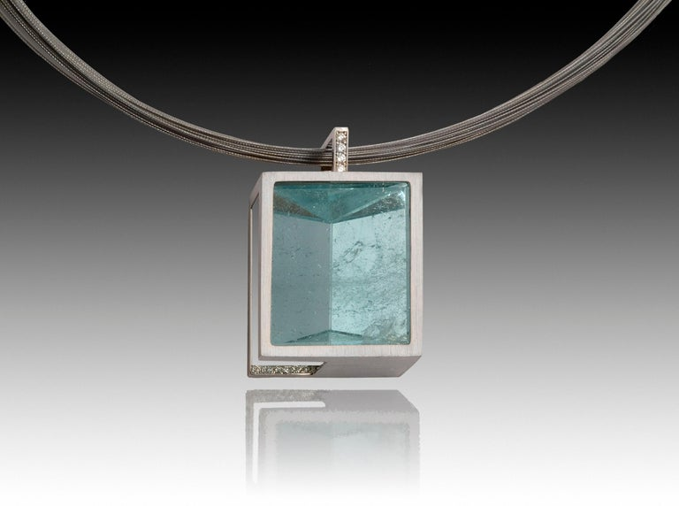 Sleek as an infinity pool, clear as the sea, unbelievably striking. This one-of-a-kind unheated large scale mirror cut aquamarine necklace is set in 14k white gold with diamond pave'. The aquamarine was cut in Austria to highlight its natural