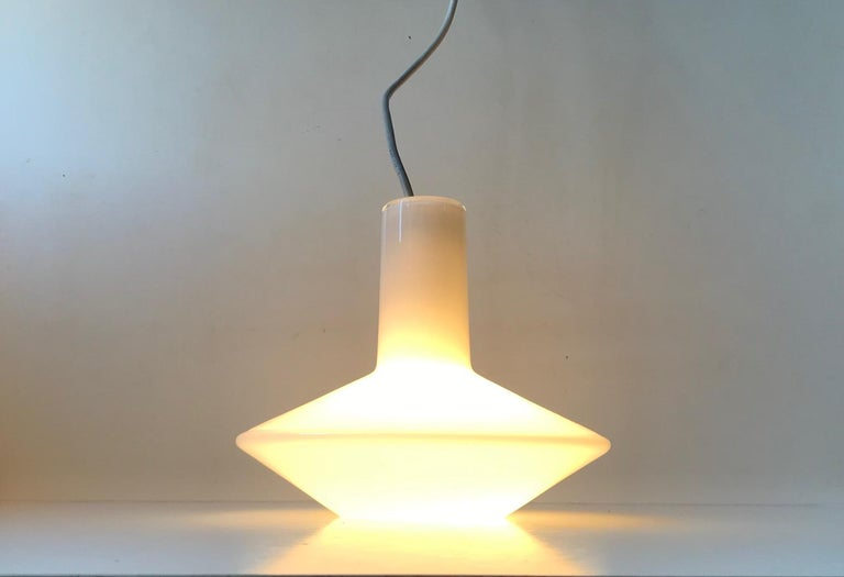 A rare cased white opaline glass pendant light designed by Sidse Werner and manufactured by Holmegaard in Denmark during the late 1970s or early 1980s. It is like Piet Hein's lamp series called Sinus.