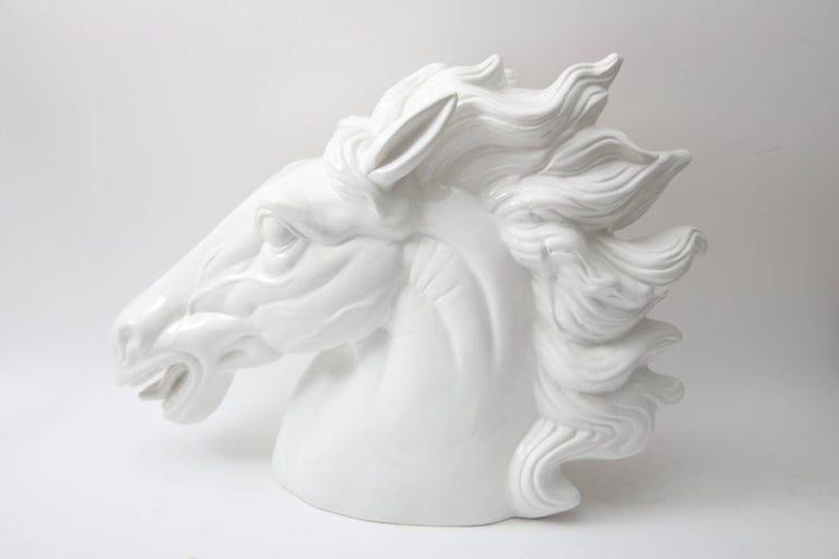 This large-scale figure of a horse head was produced in Italy and dates to the late 20th century. The white glaze gives this piece a modern look and captures the elegance and beauty of the horse.