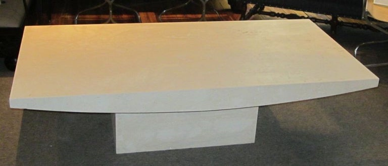 Sculptural travertine rectangular coffee table. Travertine is from Italy, table is made in the United States. See image four for surface. This table is honed and unfilled. Can be custom to any size. Choice of finishes for custom: honed and