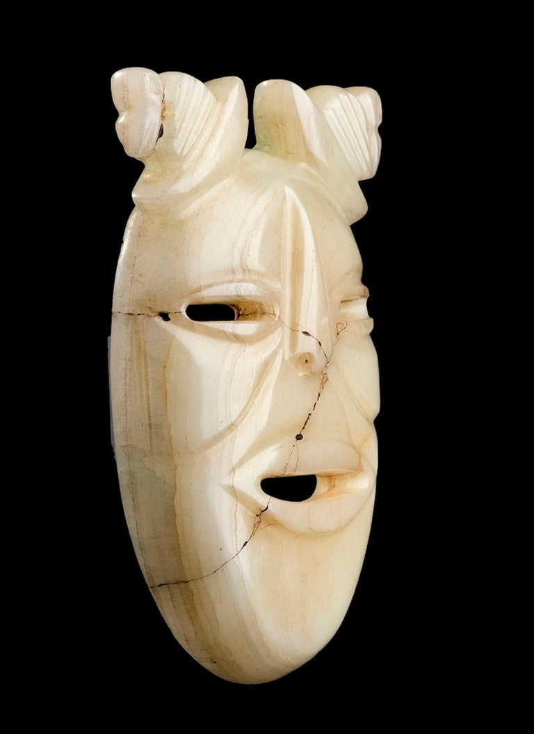White jade mask is an original Olmec's style artifacts.