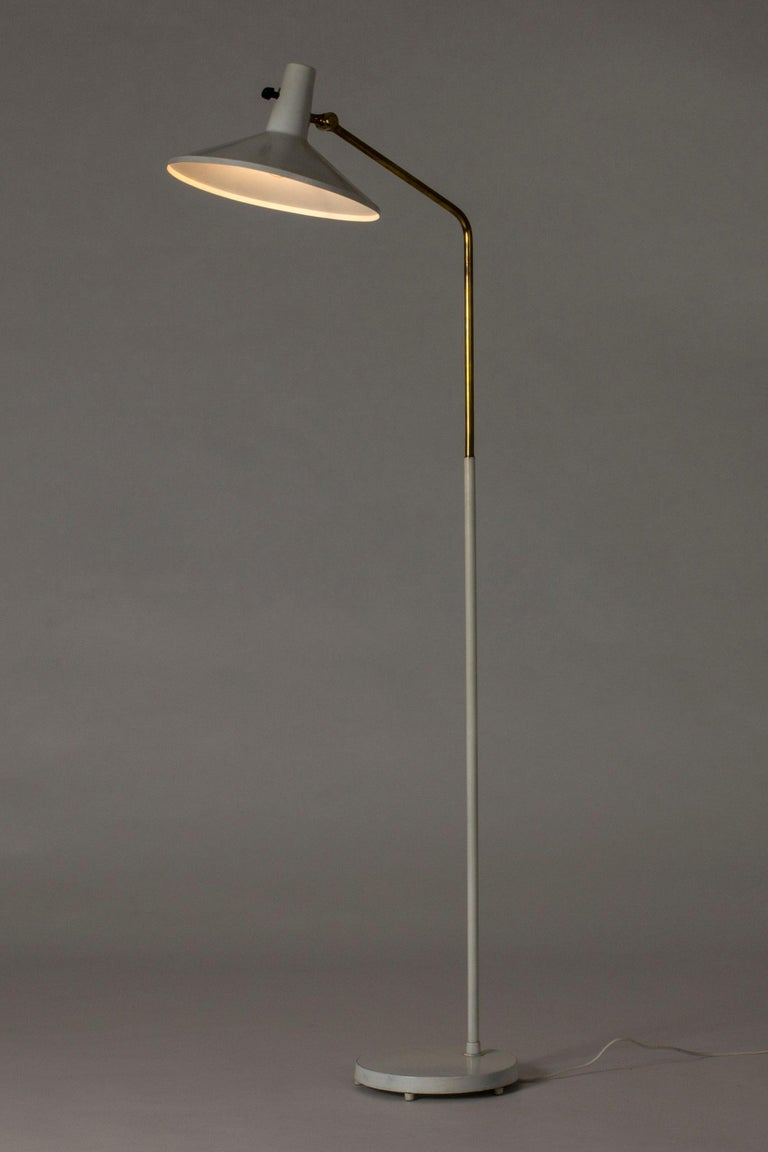 White lacquered metal and brass floor lamp with an edgy silhouette by Bertil Brisborg, designed for the lighting department at NK department store.