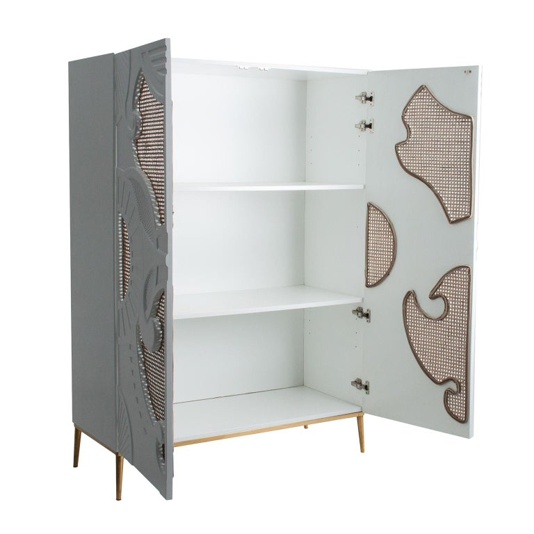 White lacquer wooden with woven cane and graphic panels doors cabinet.